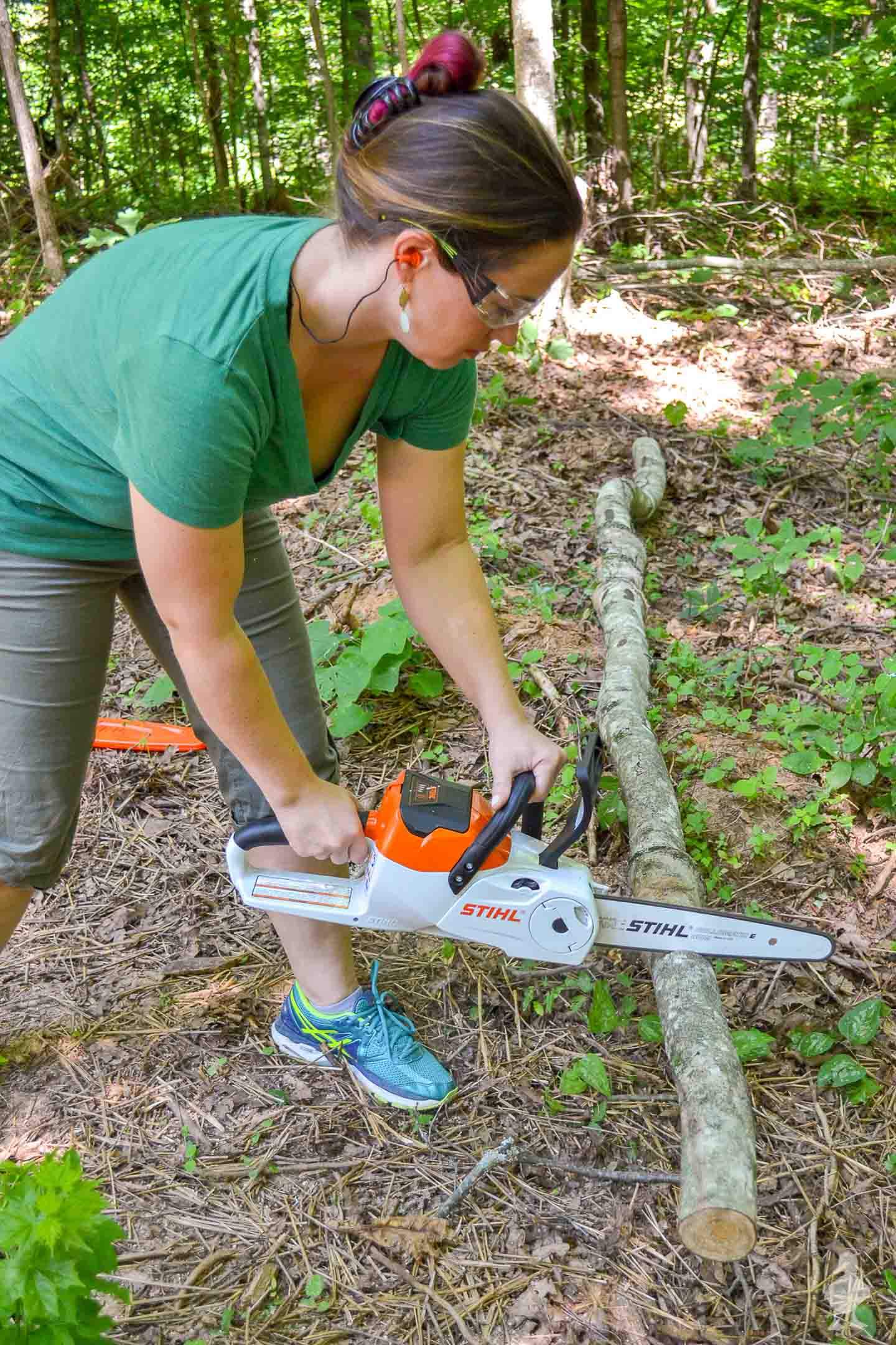 Line assembly of me cutting multiple lengths with chainsaw
