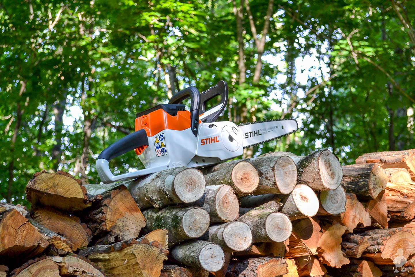 STIHL chainsaw on woodpile - 1