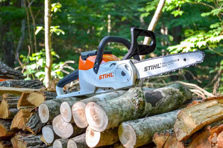 stihl chaindaw on large wood pile