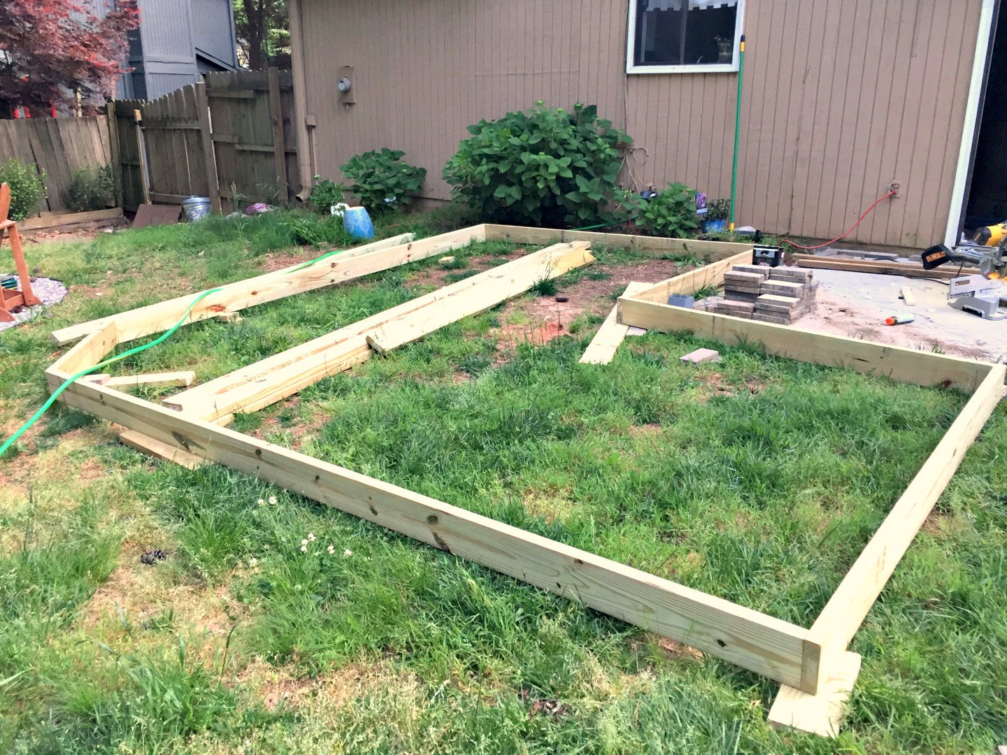 Diy floating deck part 2 frame waterproofing ugly for How to build a floating house