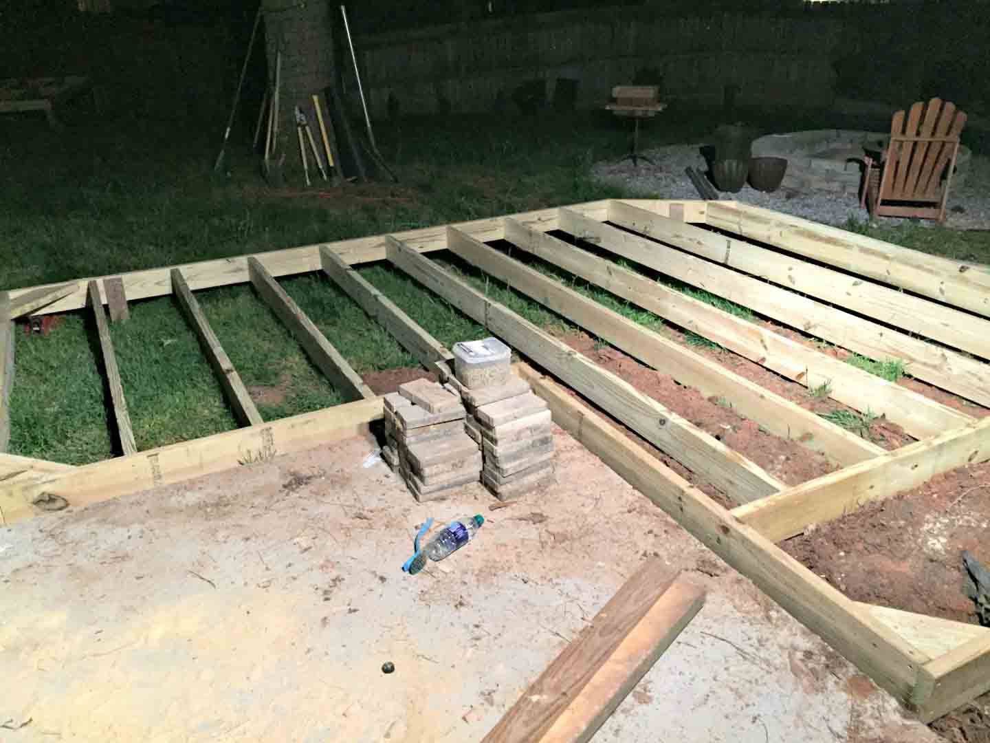 floating deck at night - base frame of ground level deck