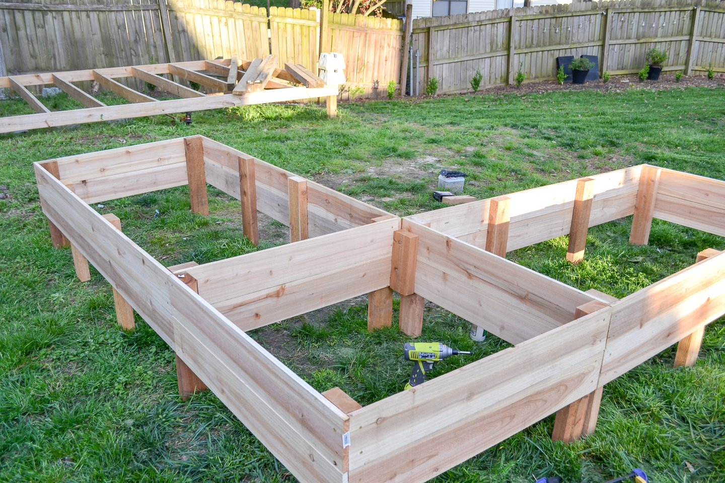 positioning new garden bed in place