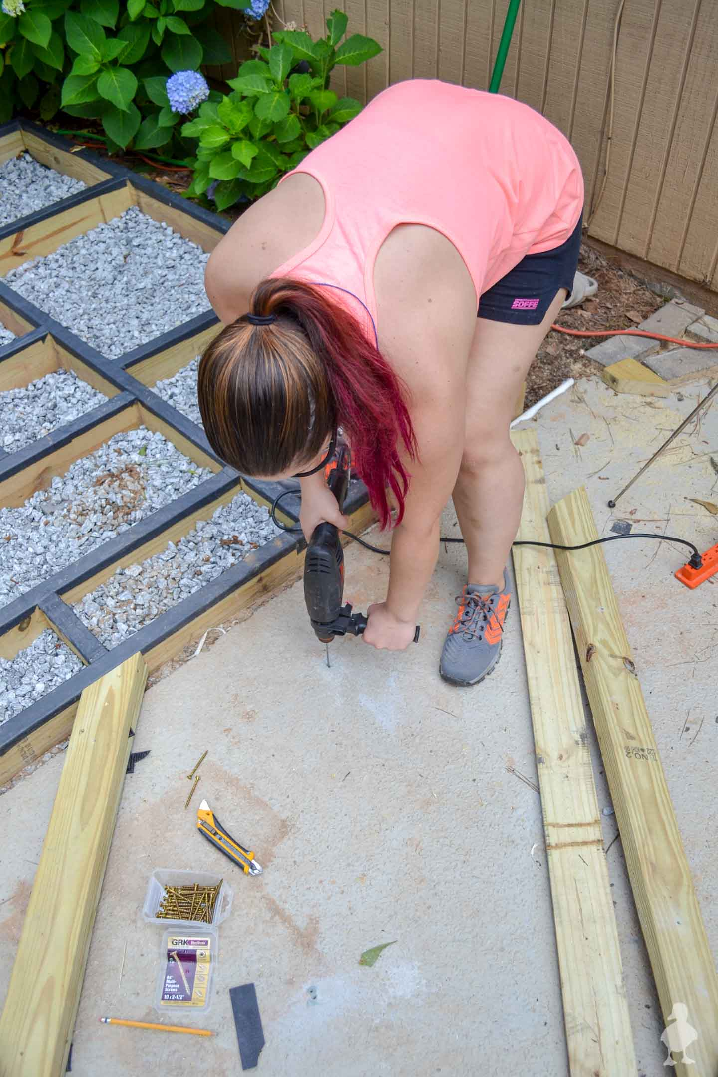use hammer drill to drill into concrete patio