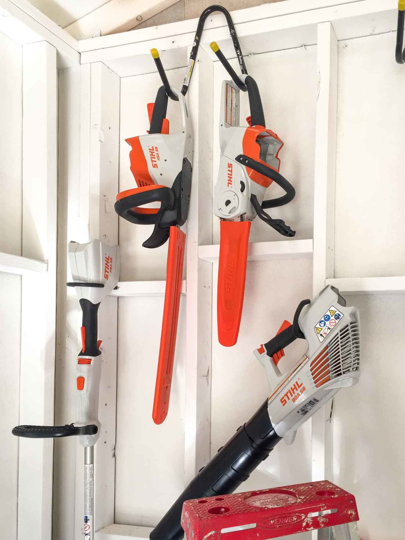 STIHL-battery-powered-tools-hanging-in-pub-shed