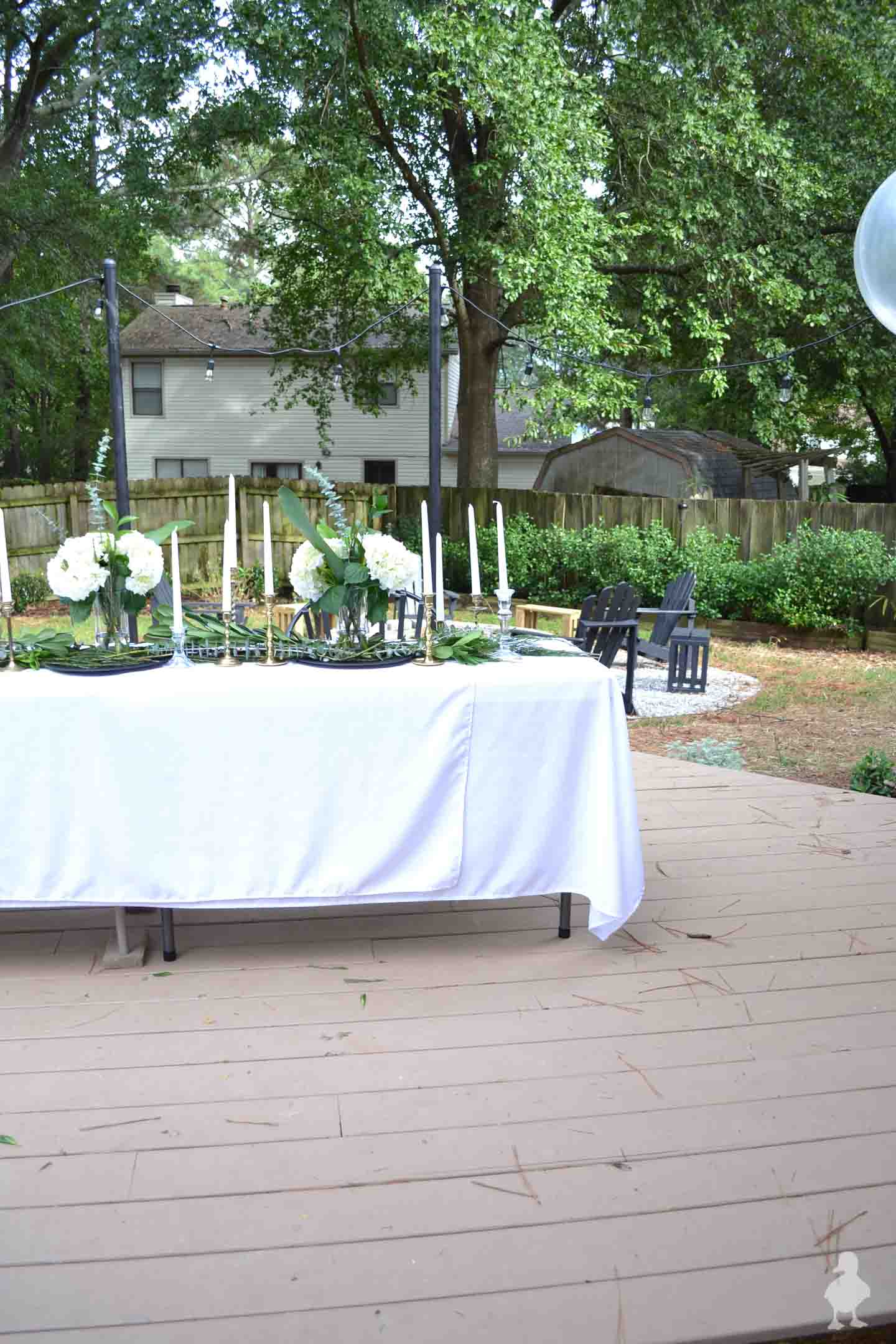 backyard dinner party with white tablecloths