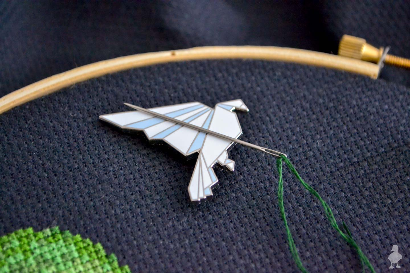 magnetic needle minder - white origami bird on black aida cross stitch fabric