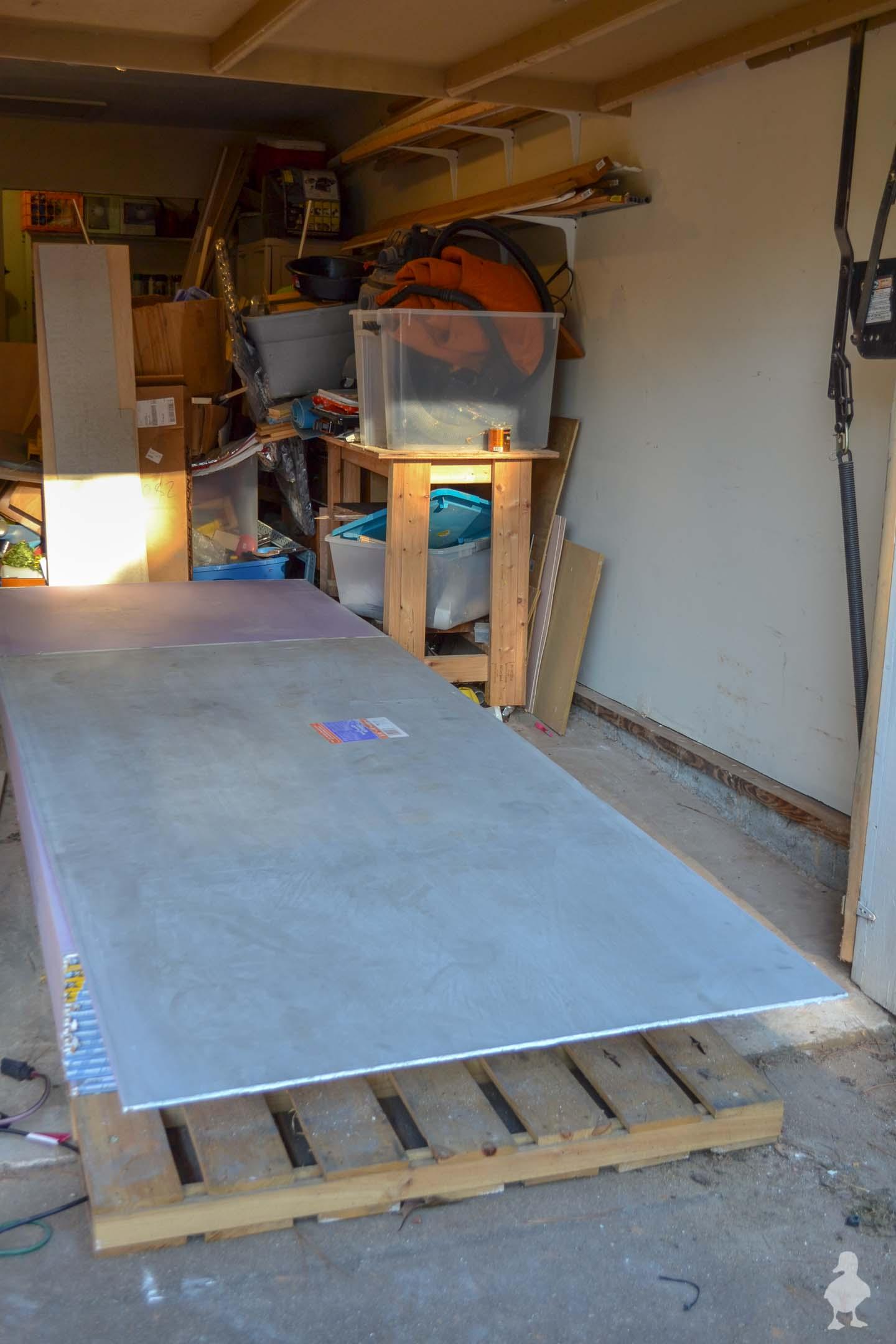super long pallet of drywall in garage