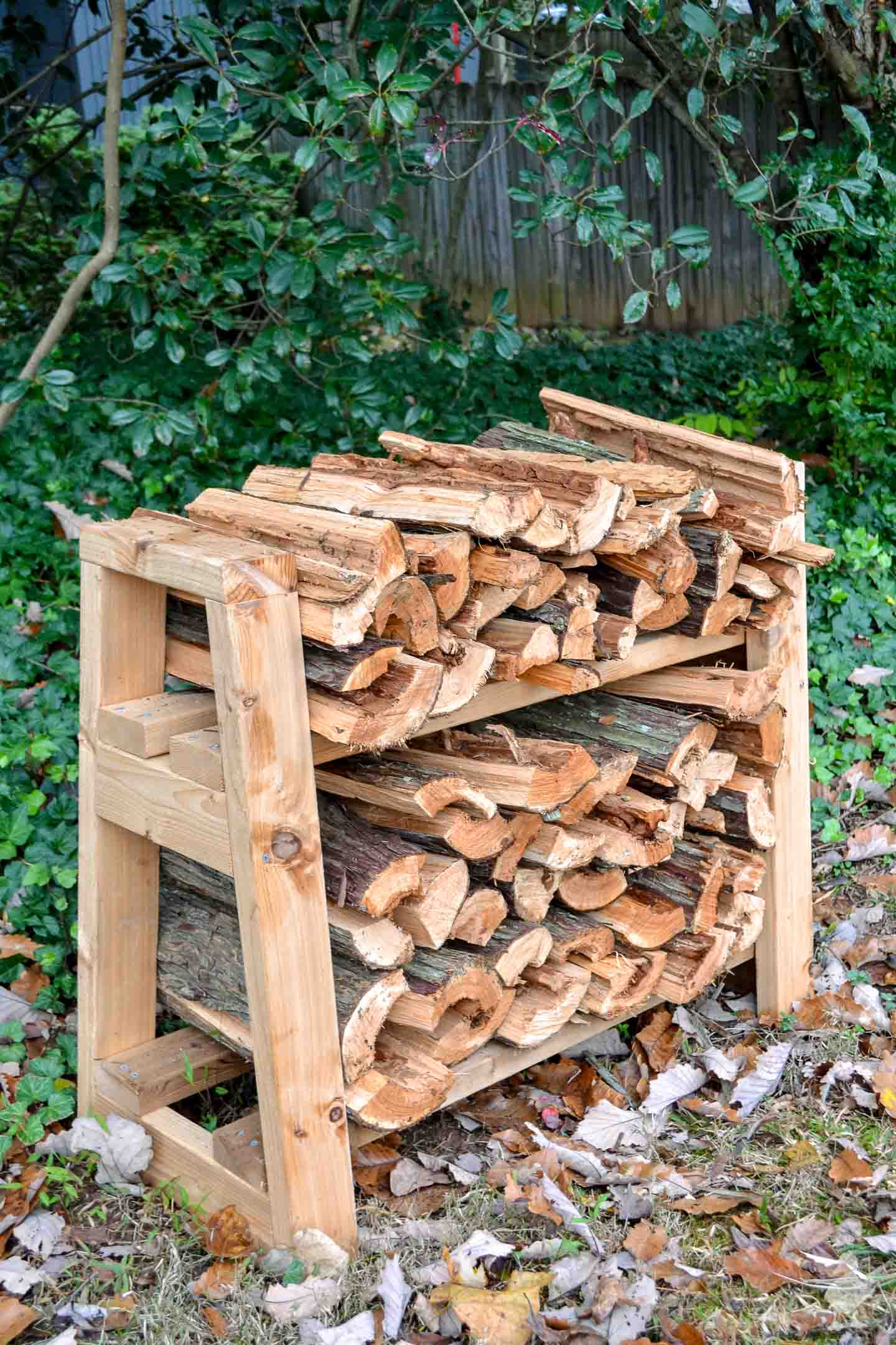 diy front porch firewood rack in ivy