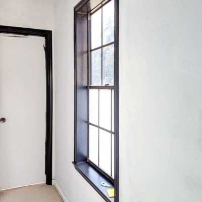 master bedroom hallway window with new window film - tricorn black paint