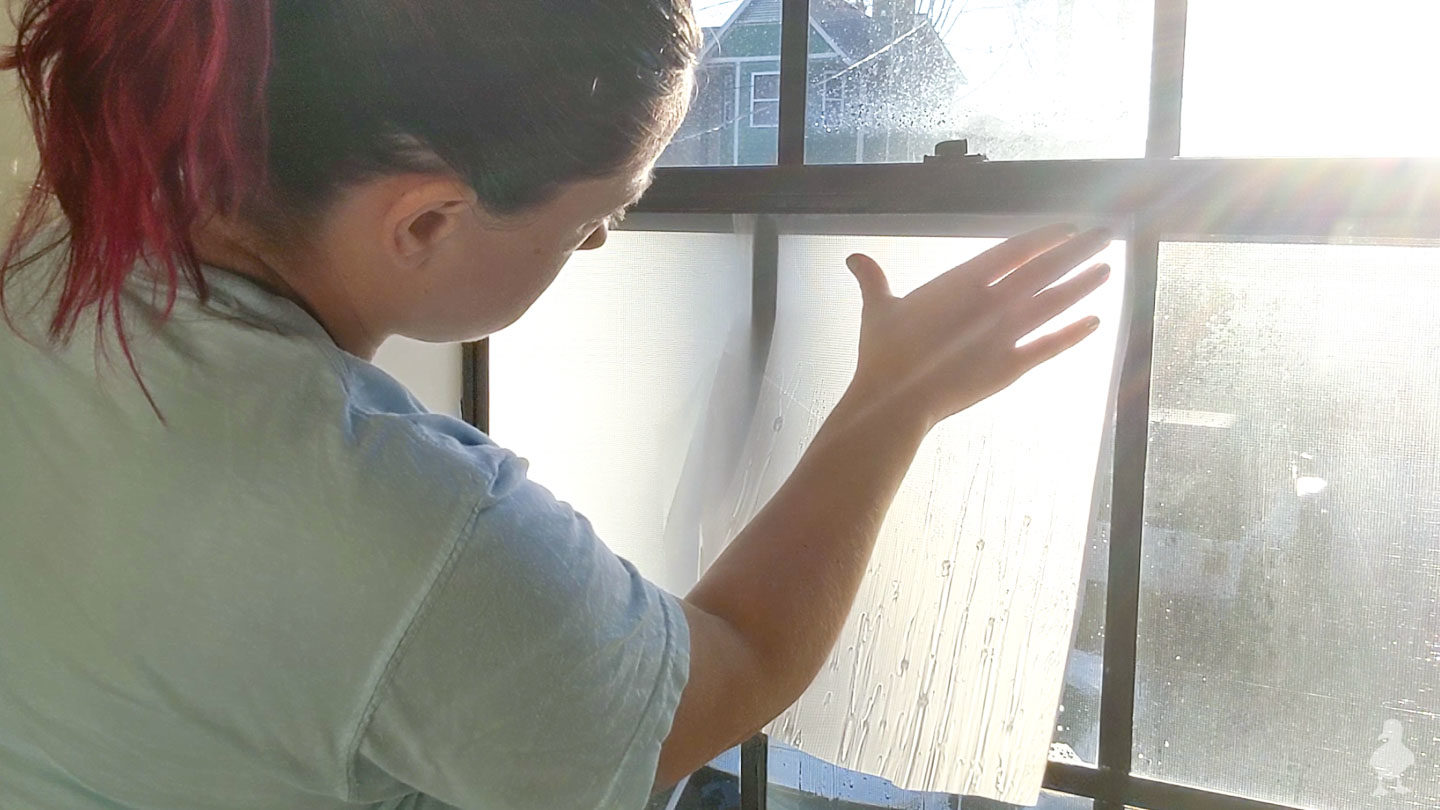 separate backing from film and apply to window