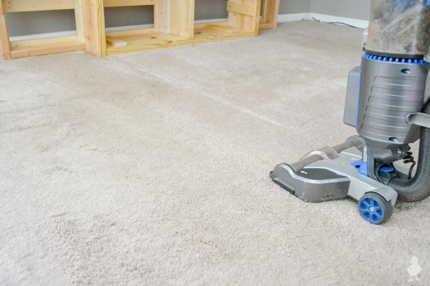 vacuuum carpet before laying down new rugs