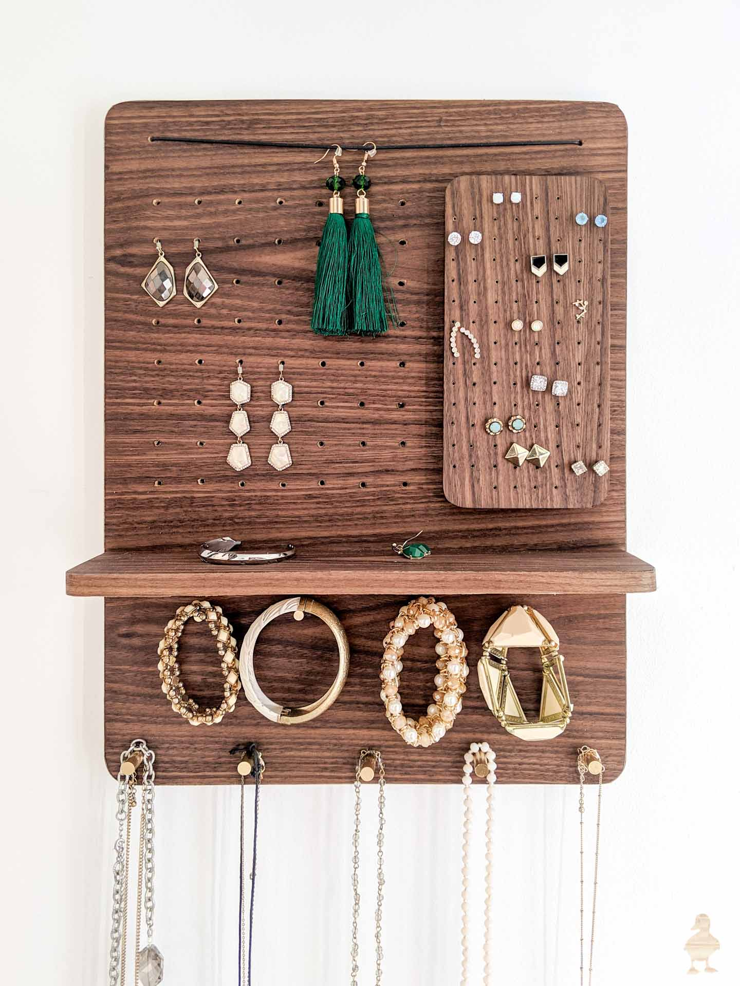 diy magnetic walnut and brass jewelry organizer idea