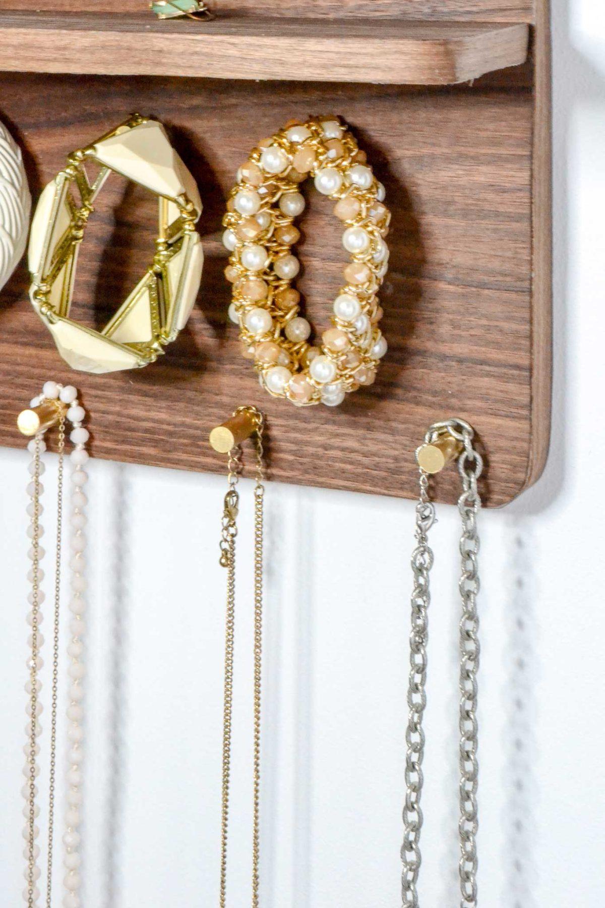 bracelets-and-necklaces-on-brass-rods