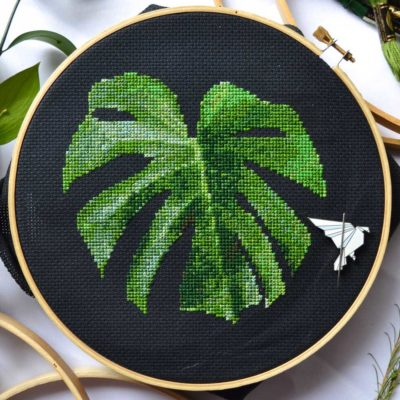 monstera leaf cross stitch pattern on black background
