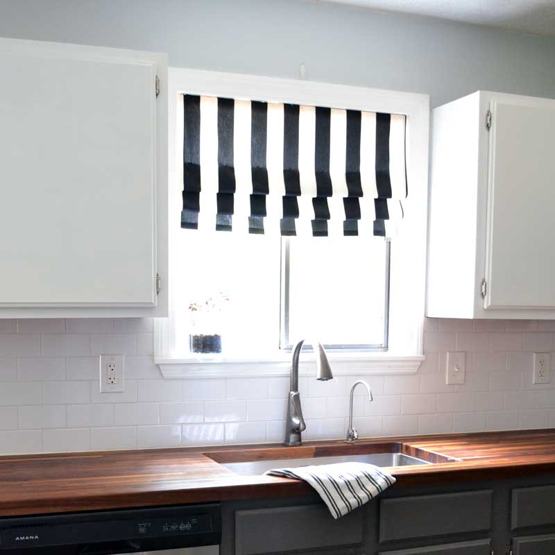 black and white striped faux roman shade in the kitchen