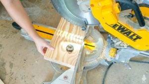 cut scrap wood into squares
