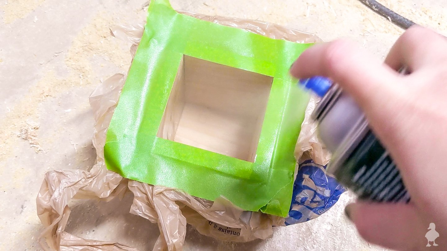 coat inside of box to protect against soil and moisture