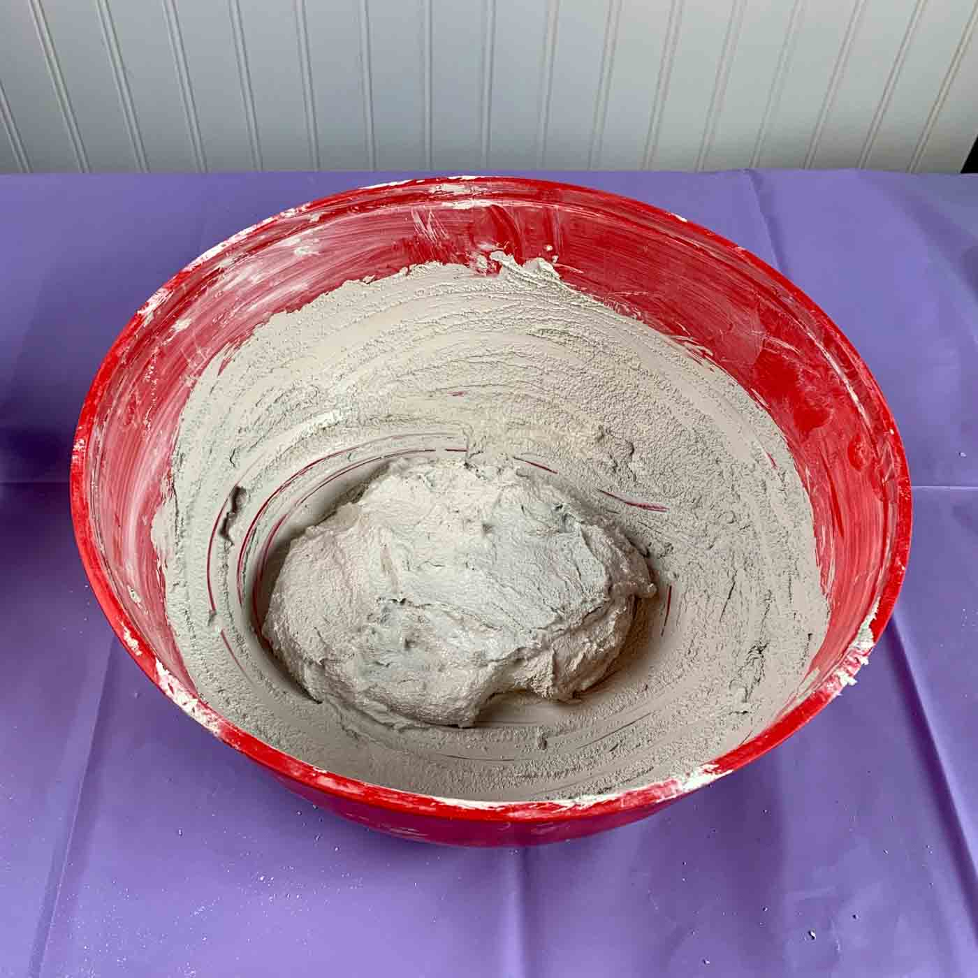 bowl with cement mix for white cement river planter