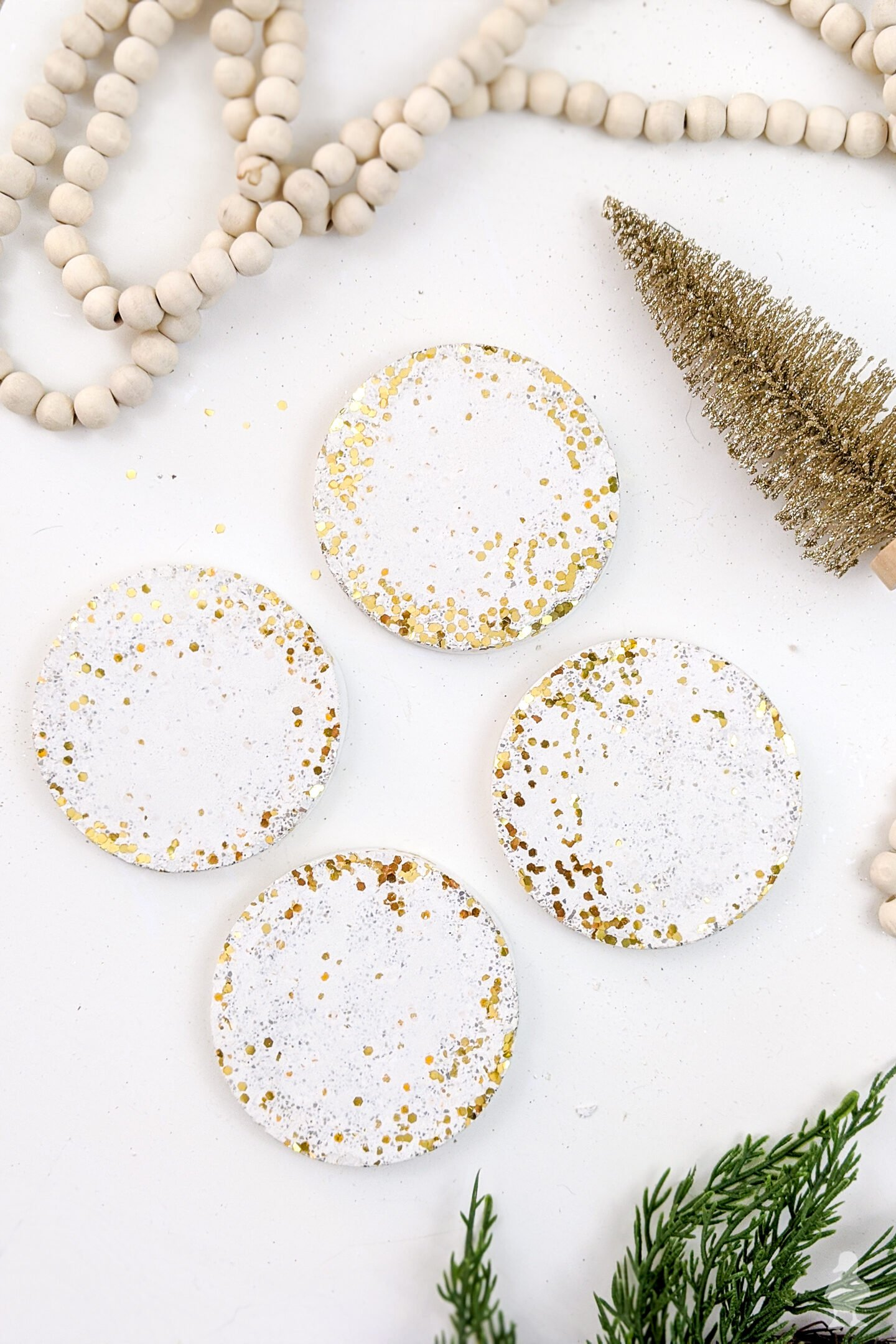 So neat! Glitter and confetti white concrete coasters can be made in an afternoon and make excellent gifts! Can also be made with kids as a Christmas craft with lots of personalized options! Get the full video and tutorial here #whiteconcrete #diycoasters #glitter #confetti #newyears #partydecoration #hostessgift #neighborgift