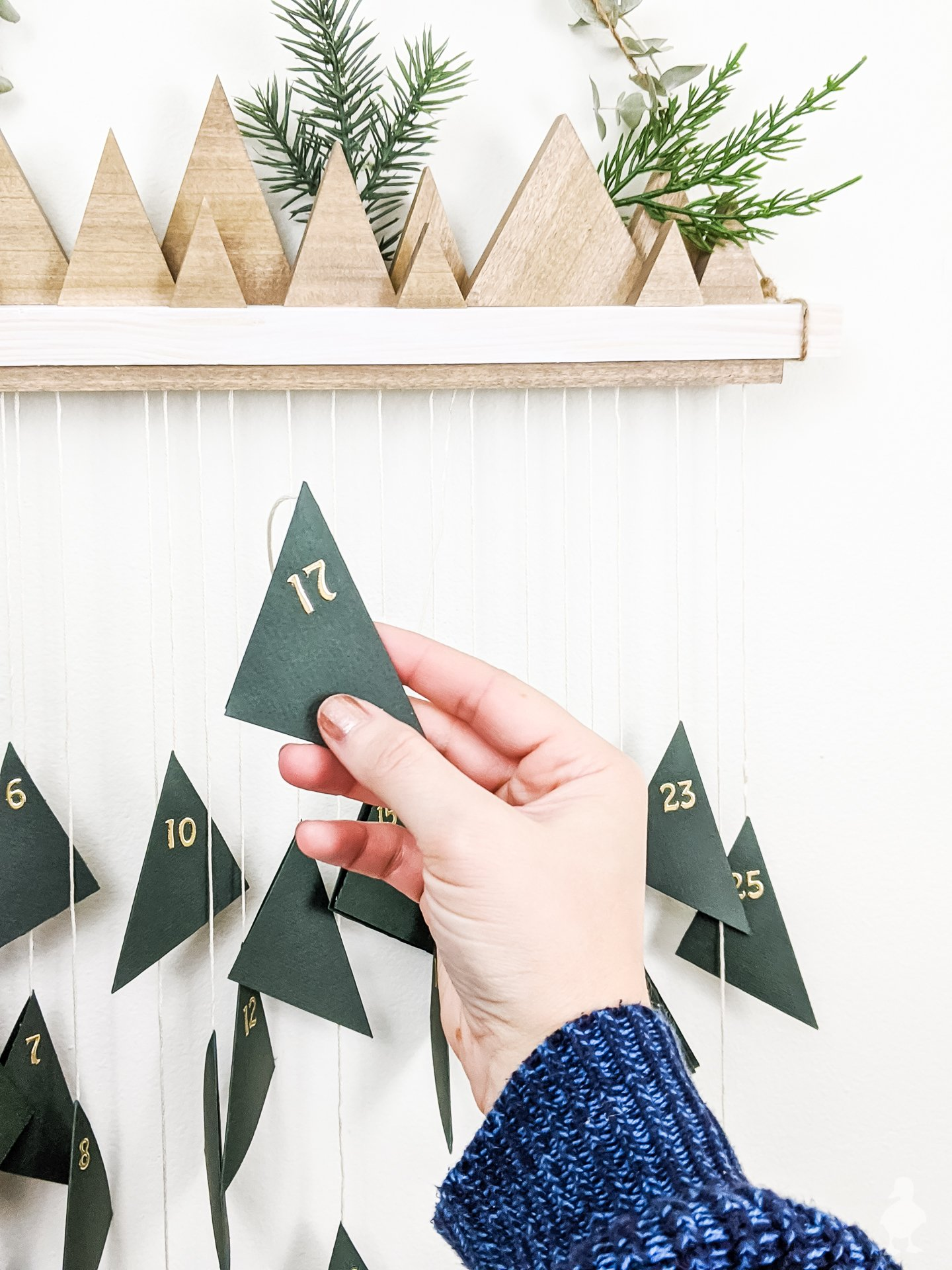number each triangle of paper with stickers