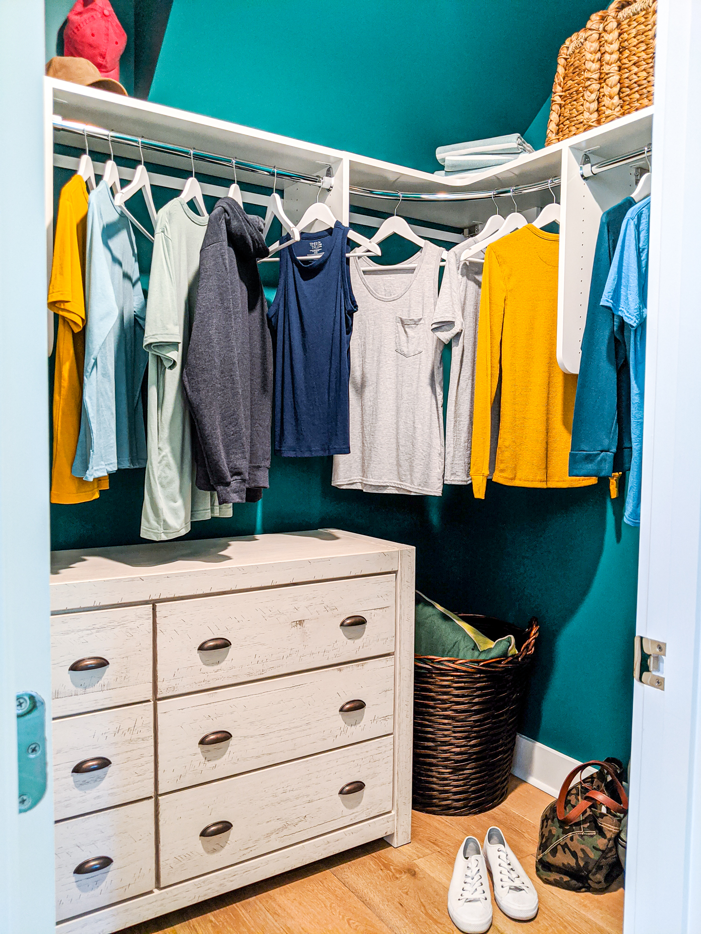 bedroom closet with teal walls