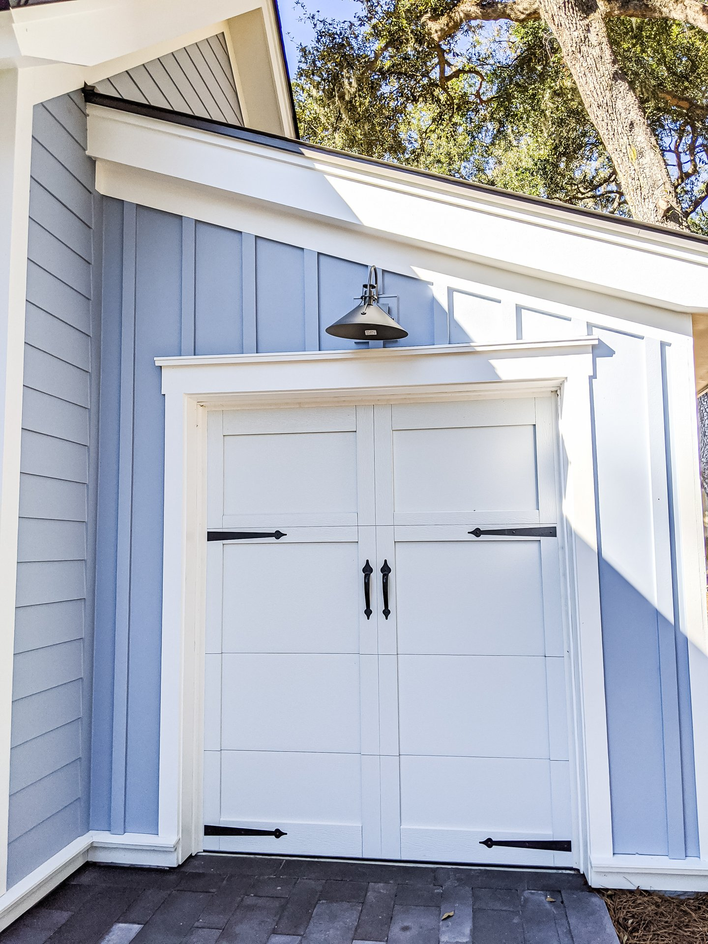 Garage door blue siding white trim