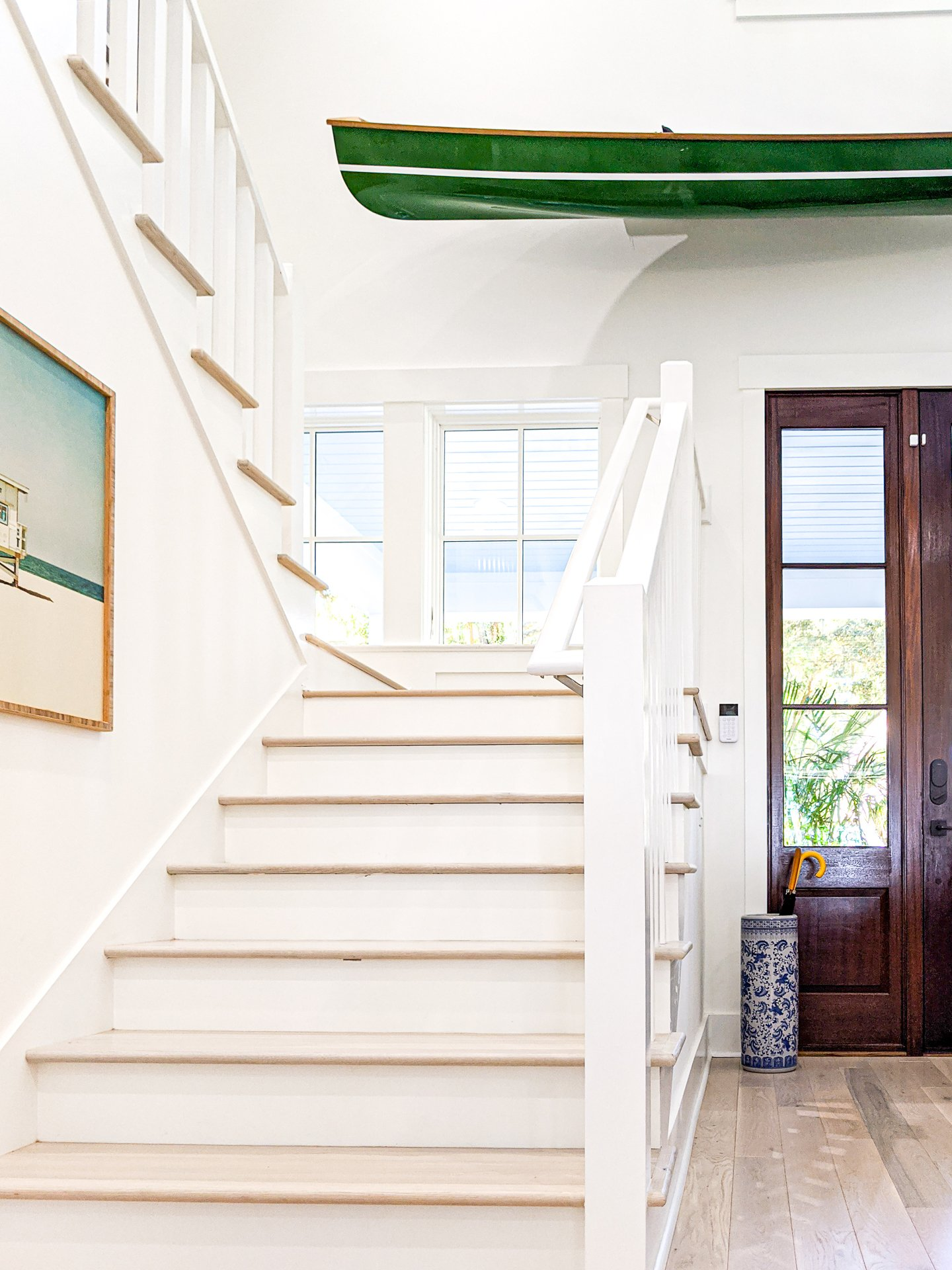 white stairs light wood treads coastal vibe entryway