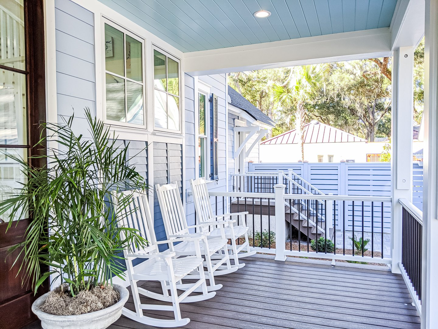 coastal southern front porch with haint blue ceiling