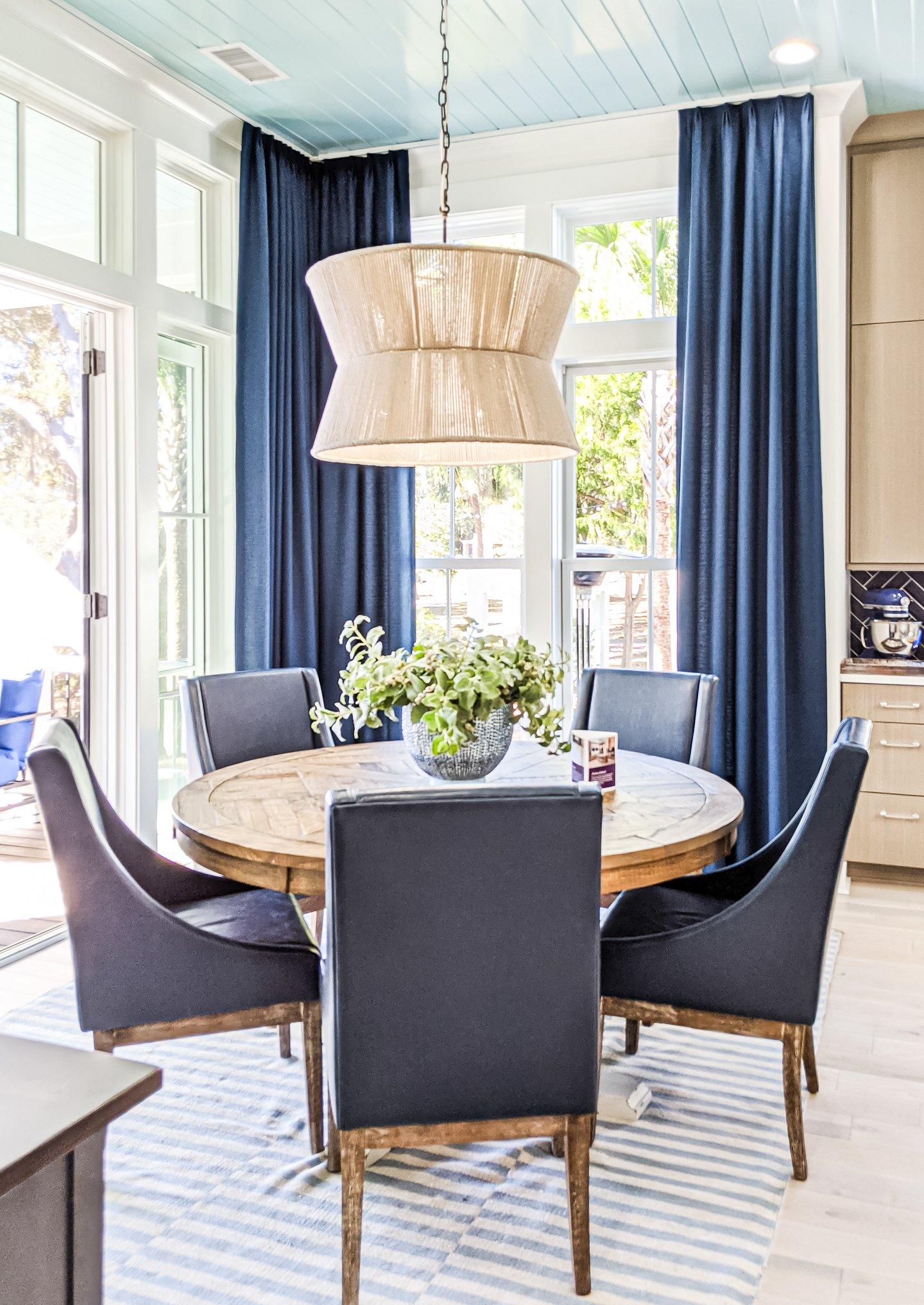 breakfast nook next to kitchen blue ceiling to floor curtains