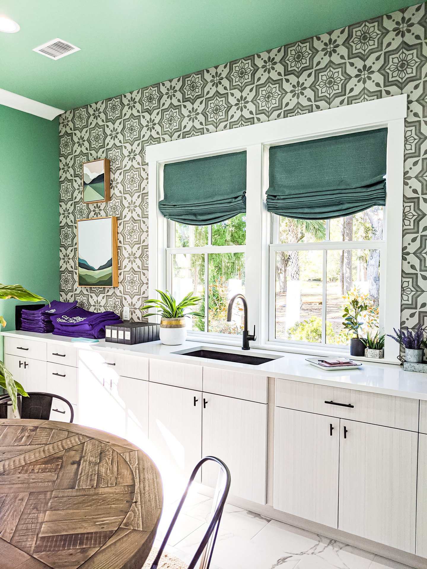 HGTV laundry room mudroom teal walls cement pattern tile