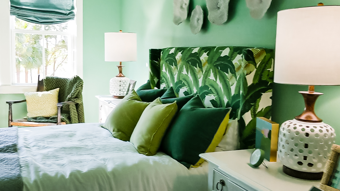 green bedroom with palm front print headboard