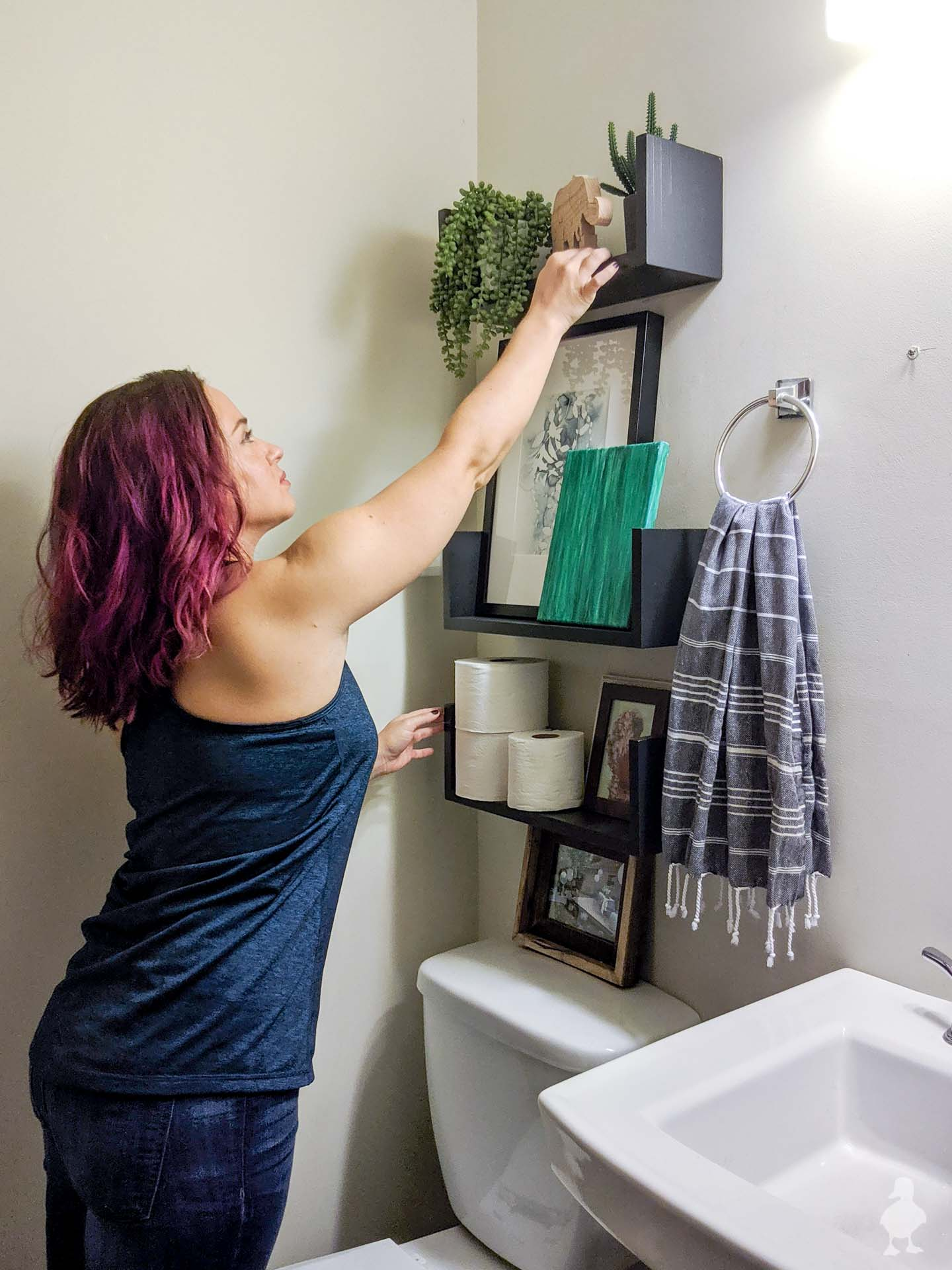 styling floating u shelves in downstairs half bath