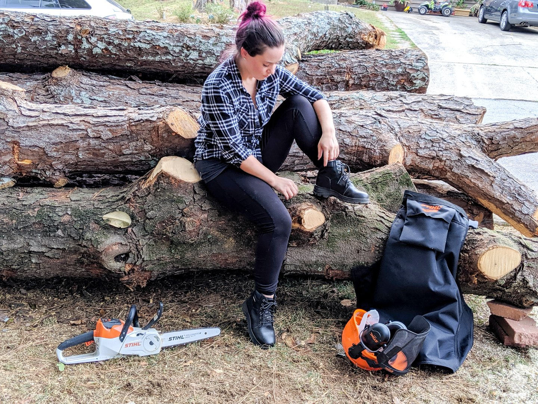 Sarah Fogle with chainsaw gear