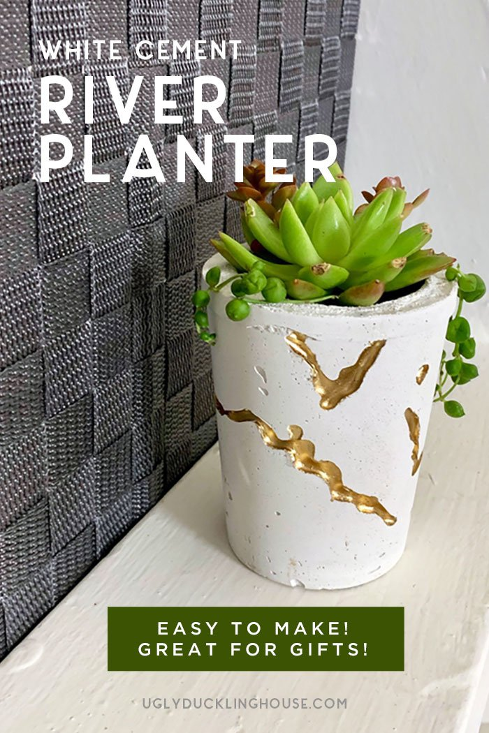 diy white cement river concrete planter with gold paint and succulent