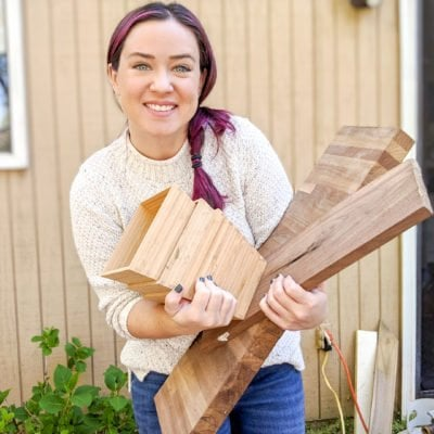 ten years of Ugly Duckling House - Sarah holding scrap wood