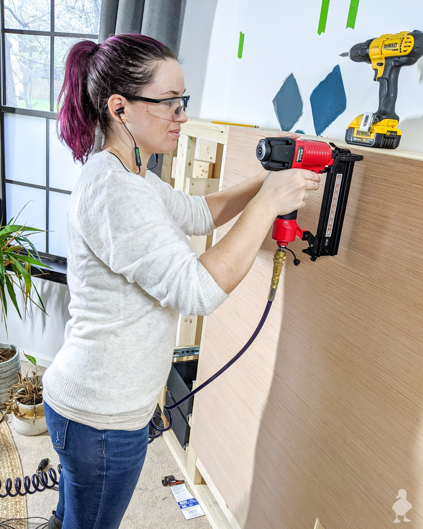 using arrow pneumatic nail gun on master bedroom feature wall