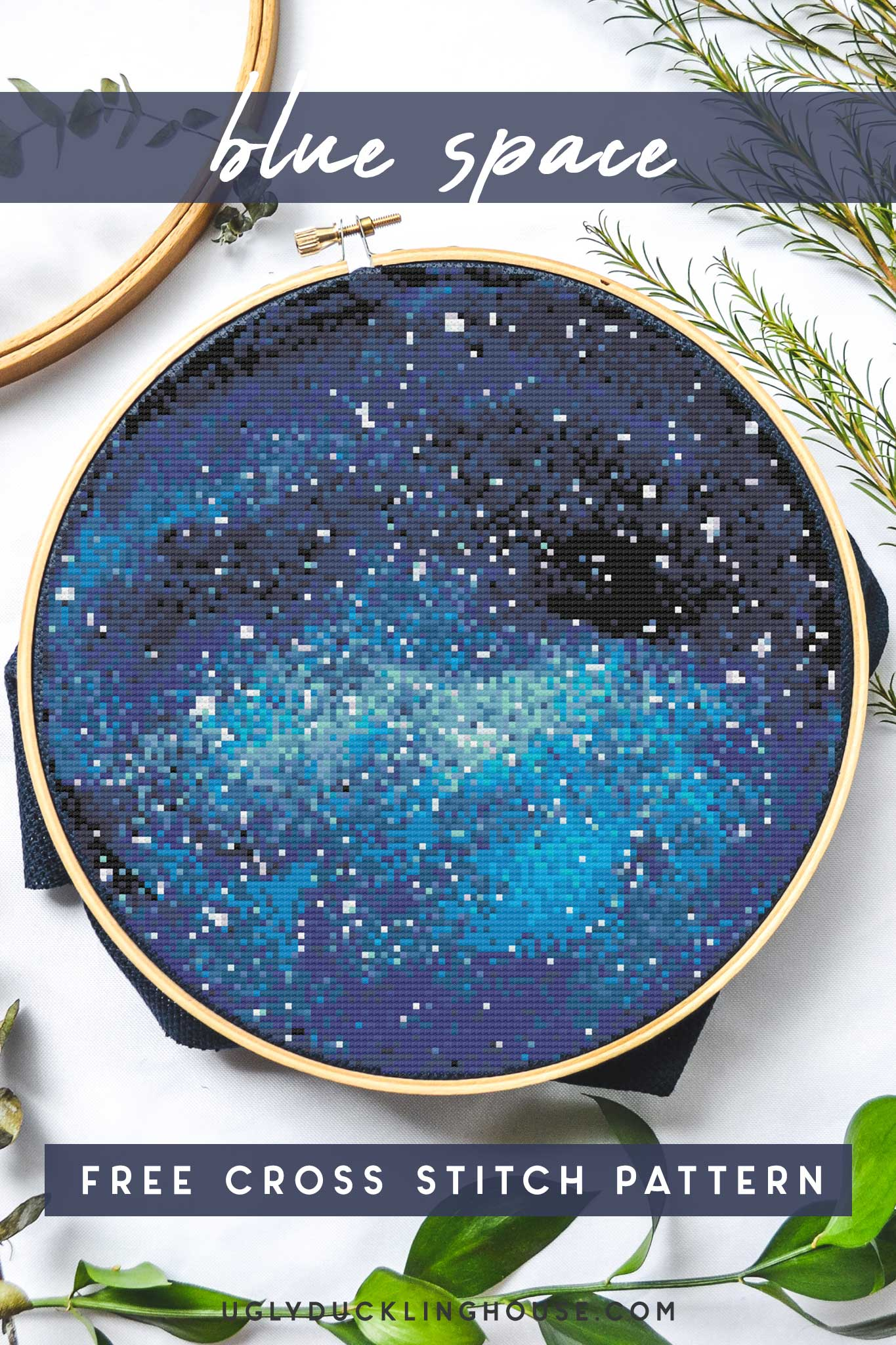 blue space galaxy cross stitch pattern on white background