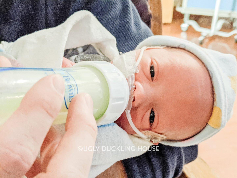 Ellis opening his eyes while bottle feeding in the NICU - Covid preemie life