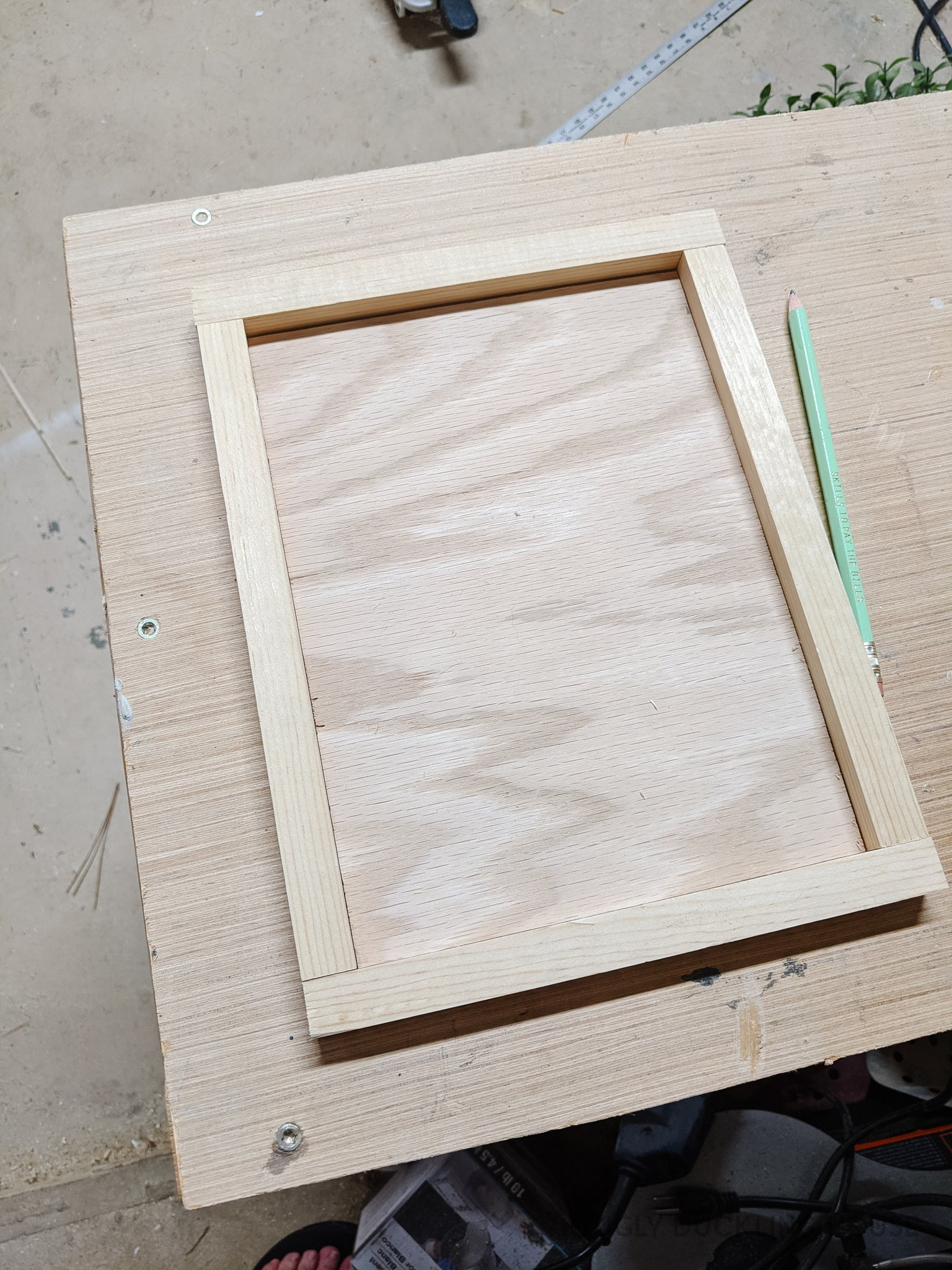 cut a frame to fit around the backer