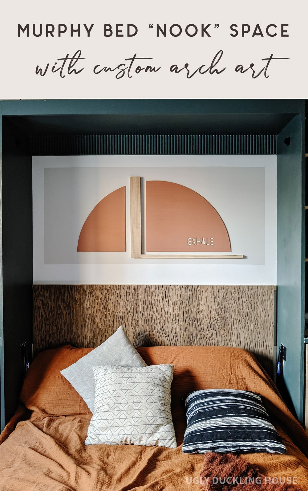 murphy bed nook space with custom arch art