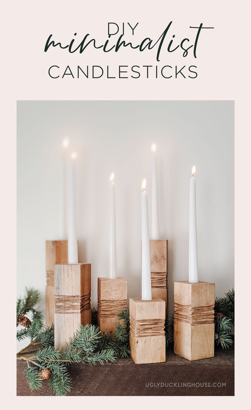 DIY minimalist wooden candle holders with tapered white candles as Christmas decor