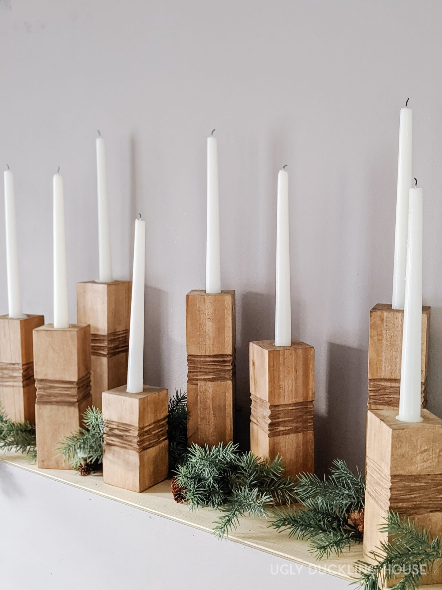 using wax to position tapered candles vertically for candlesticks