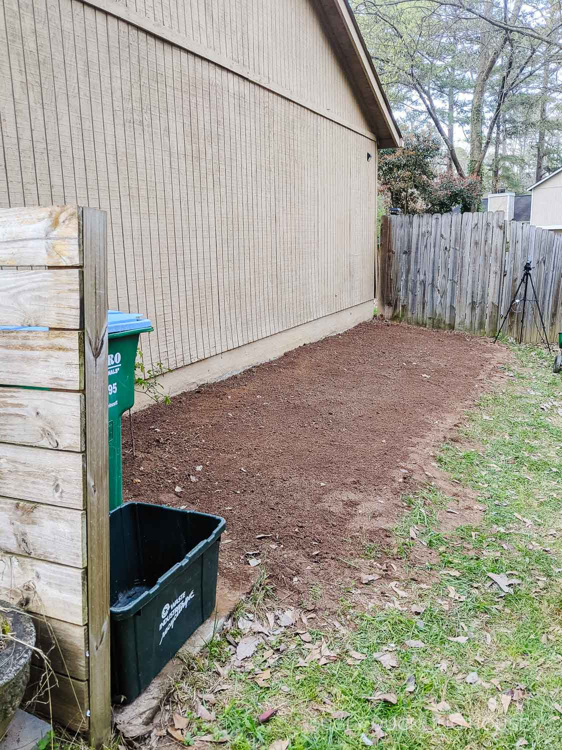 breaking up the soil on the side of the house in prep for new garden