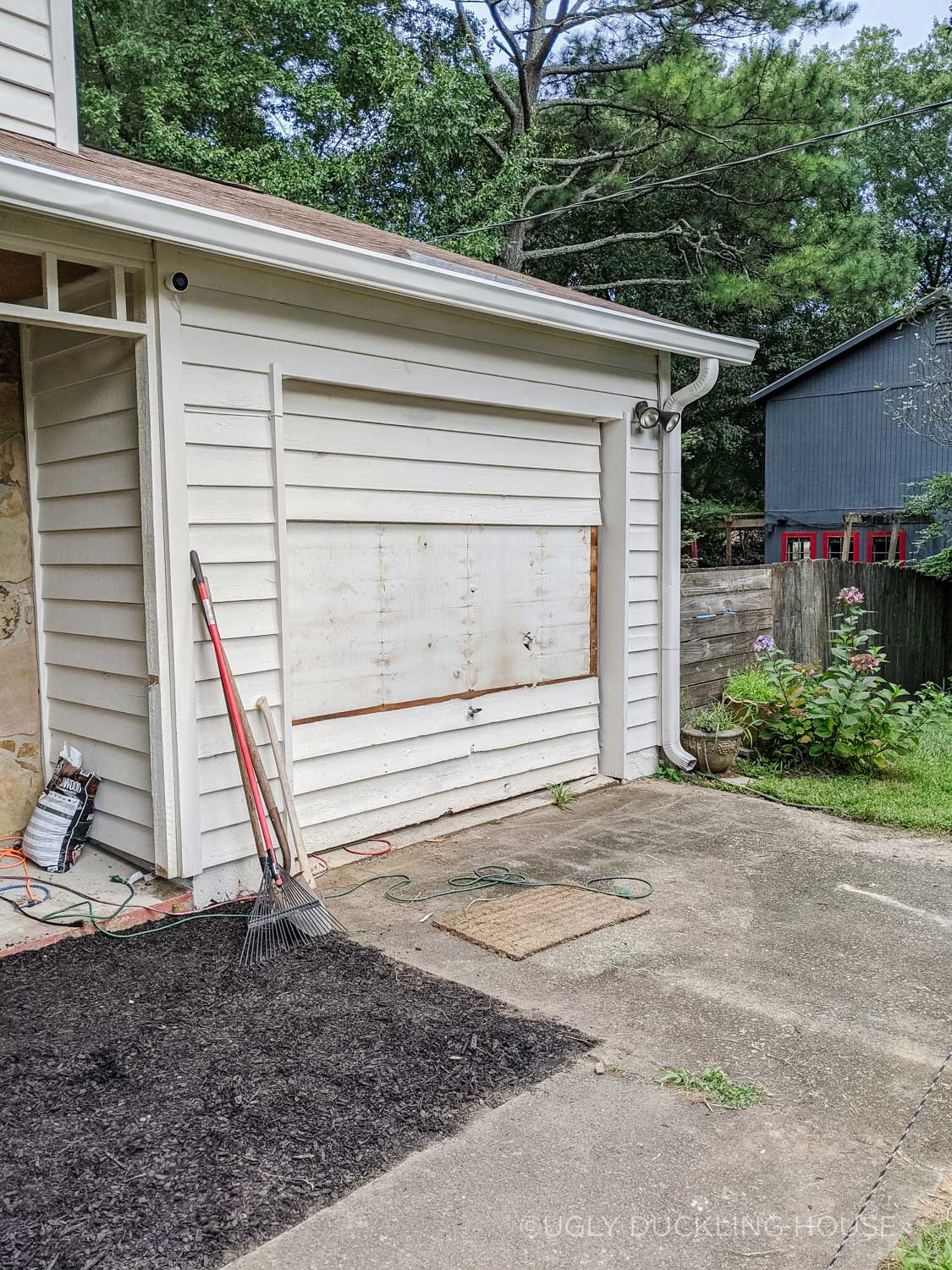 removing the old siding from the garage door