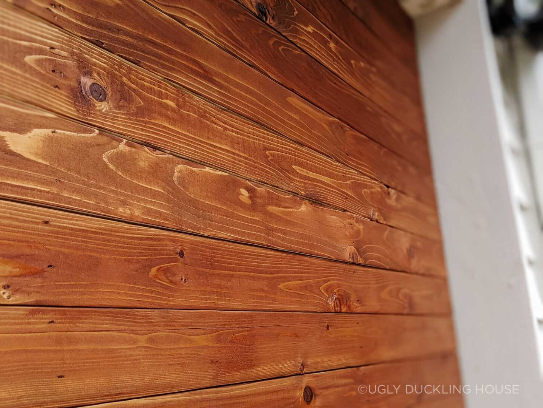 closeup of new stain on new garage door boards