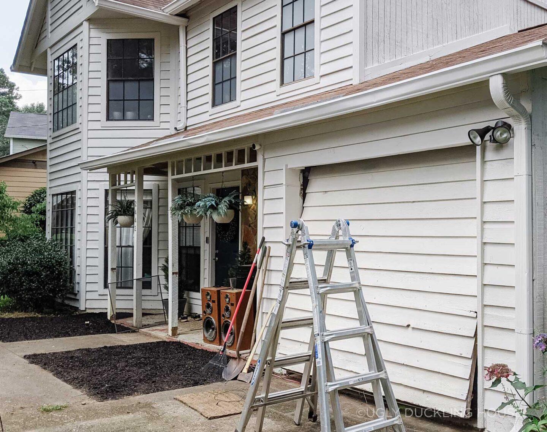 before - white siding on garage door